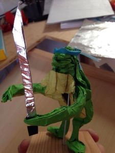 Adolescent Metamorphed Samurai Reptile.  Reptile, Headband, and Sword each folded from one uncut square.